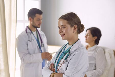 Patient with a group of doctors at the background