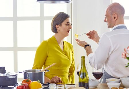 Smiling young couple cooking food in the kitchen