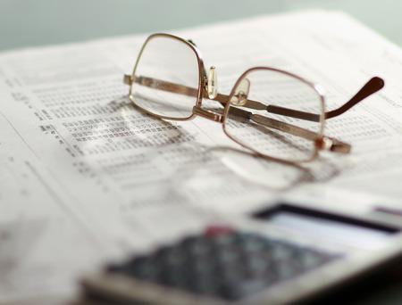 Newspaper and glasses Calculator