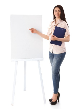 Young woman standing near board with folder photo