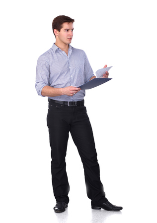 Young man standing with folder, isolated on white background photo