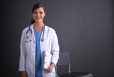 Young doctor or medic with clipboard and stethoscope isolated o photo