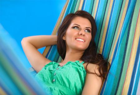 Beautiful Young Woman relaxing in hammock photo