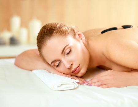Spa Woman.Hot Stones Massage photo