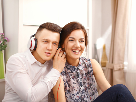 Young couple relaxing and listening music together photo
