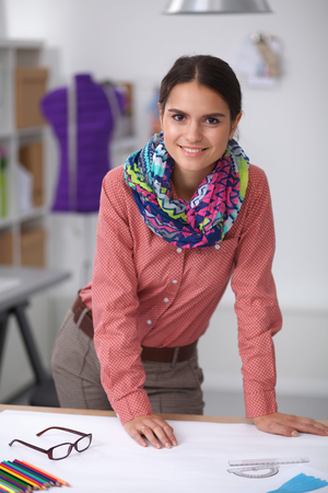 textile industry: Modern young fashion designer working at studio.
