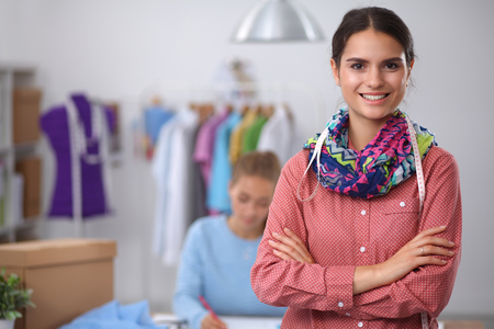 small business owner: Modern young fashion designer working at studio.