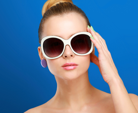mini purse: Portrait of young beautiful woman in sunglasses Stock Photo
