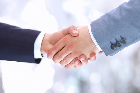 Handshake - Hand holding on white  photo