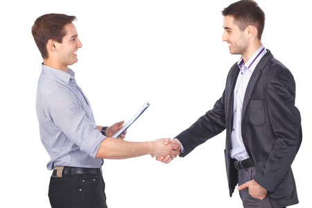 Two business men shaking hands and one of them holding a folder Stock Photo