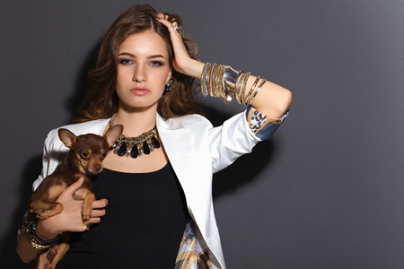 beautiful glamour woman in sunglasses with small dog photo
