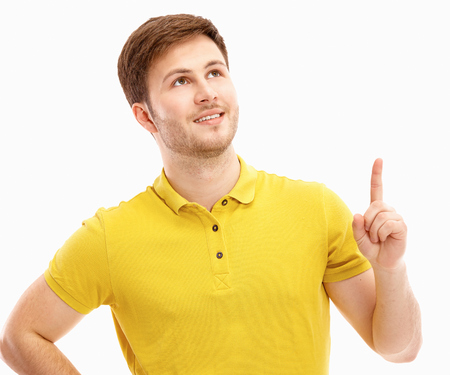man pointing up: young man pointing up. Stock Photo