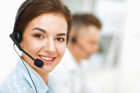 Attractive young people working in a call center Stock Photo - 32716439