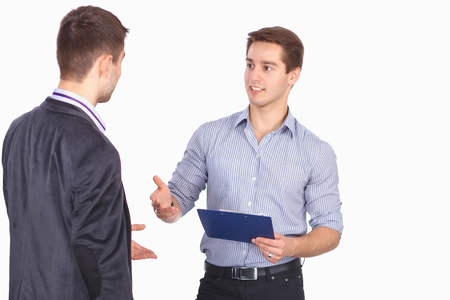 Two business men shaking hands and one of them holding a folder with contract photo
