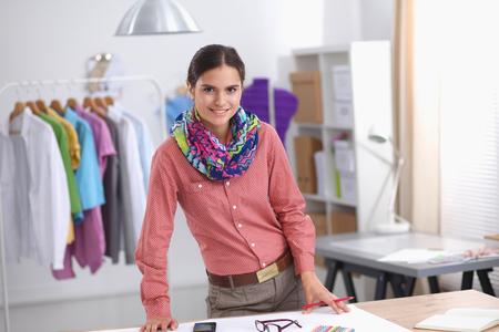 textile designer: Modern young fashion designer working at studio.