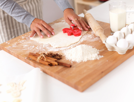 Woman making christmas cookies in the kitchen photo