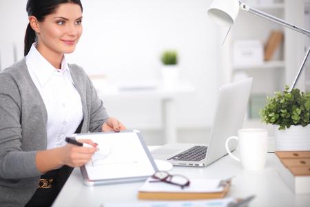 Beautiful businesswoman handing over paperwork extending her hand photo