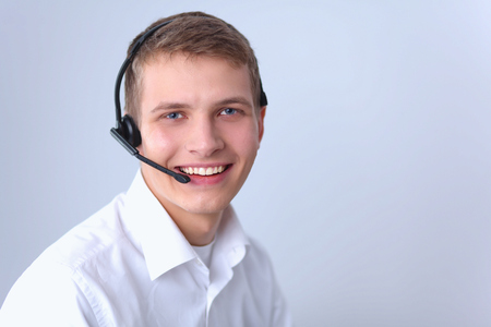 hands free phones: Customer support operator with a headset isolated on white