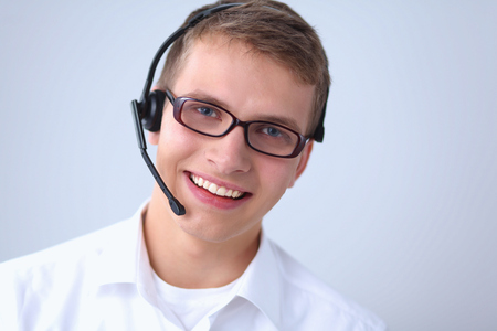 hands free device: Customer support operator with a headset isolated on white