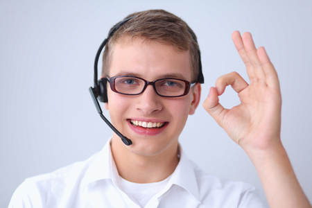 hands free phones: Customer service agent showing ok, isolated on white