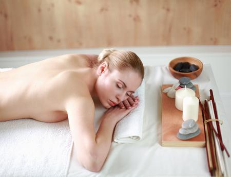 holistic care: Beautiful young woman getting spa massage, lying on salon