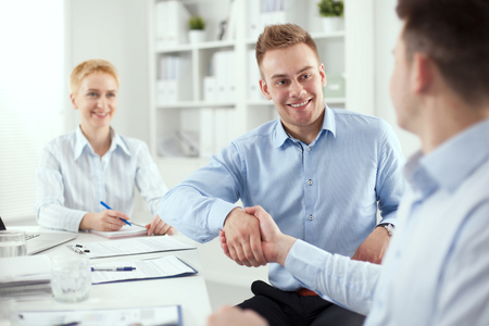 people together: Business people shaking hands, finishing up a meeting Stock Photo
