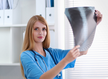 Female doctor showing x-ray at hospital photo