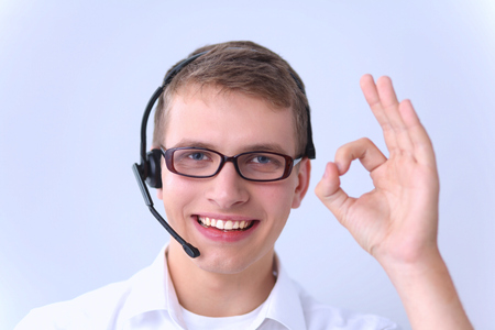 hands free device: Customer service agent showing ok, isolated on white background Stock Photo