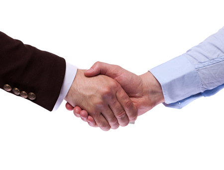 business handshake: Two business people handshake, sitting in the office