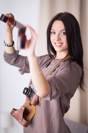 Woman is a proffessional photographer with camera photo