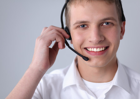 hands free phones: Customer support operator with a headset on white background
