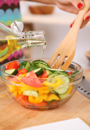 the mixing: Young woman mixing fresh salad Stock Photo