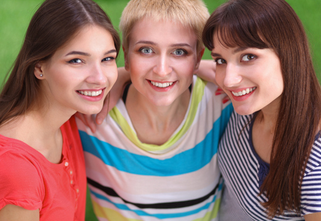 3 persons only: Portrait of three young women, standing together Stock Photo
