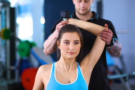 personal trainer: gym woman personal trainer man. Stock Photo