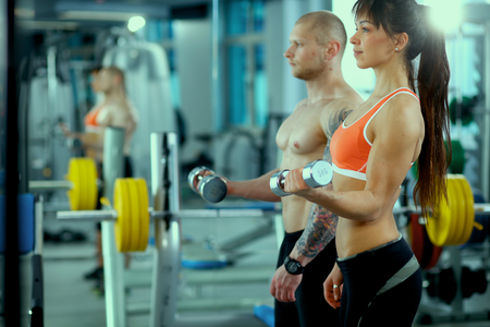 people in sport fitness gym