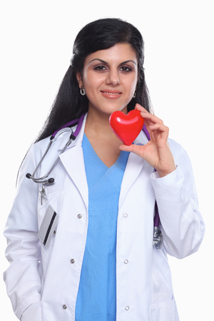 Doctor with stethoscope holding heart, isolated on white  background photo