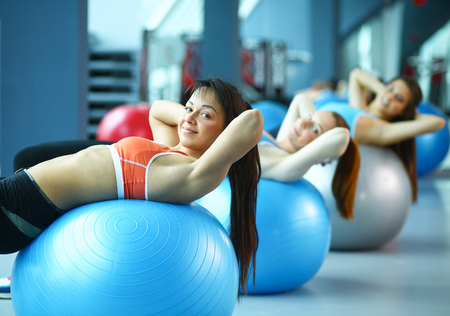 Group of people in a Pilates class at the gym Stock Photo