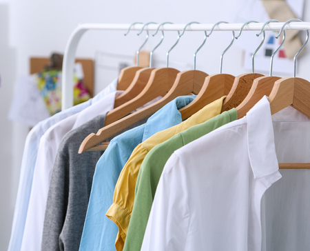 Clothes hang on a shelf in  designer clothes store Stock Photo