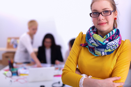 female architect: Portrait of a young woman working at office Stock Photo
