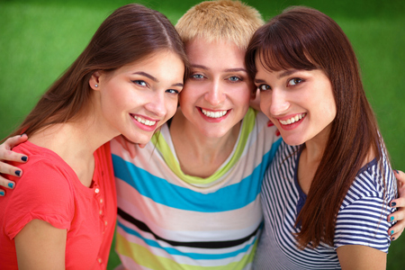 three persons only: Portrait of three young women, standing together Stock Photo