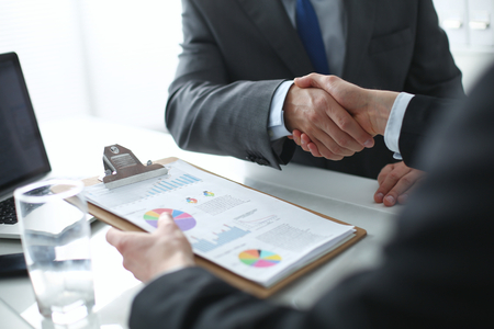 team hands: Business people shaking hands, finishing up a meeting Stock Photo