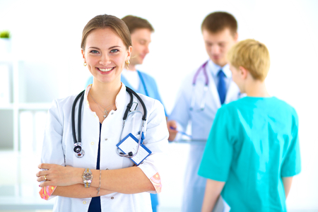 Woman doctor standing with stethoscope at hospital Stock Photo
