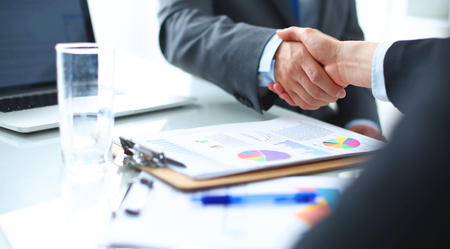 female lawyer: Business people shaking hands, finishing up a meeting Stock Photo