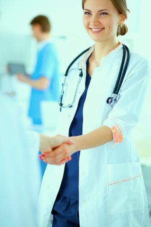 Young medical people handshaking at office photo