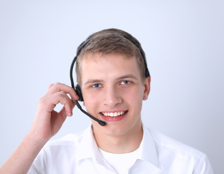 hands free device: Customer support operator with a headset on white background