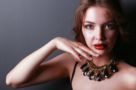 forearms: Portrait of young beautiful woman with jewelry