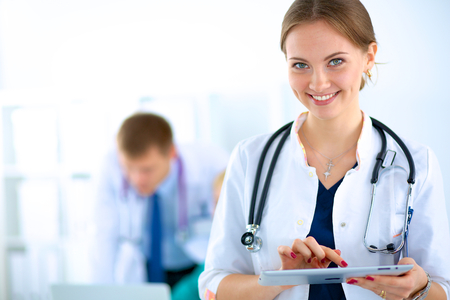 Young woman  doctor holding a tablet pc