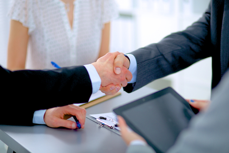 Business people shaking hands, finishing up a meeting Stock Photo - 40182993