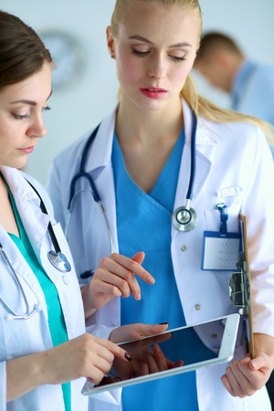Young women doctors holding a tablet pc