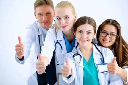 Portrait of doctors team showing thumbs up